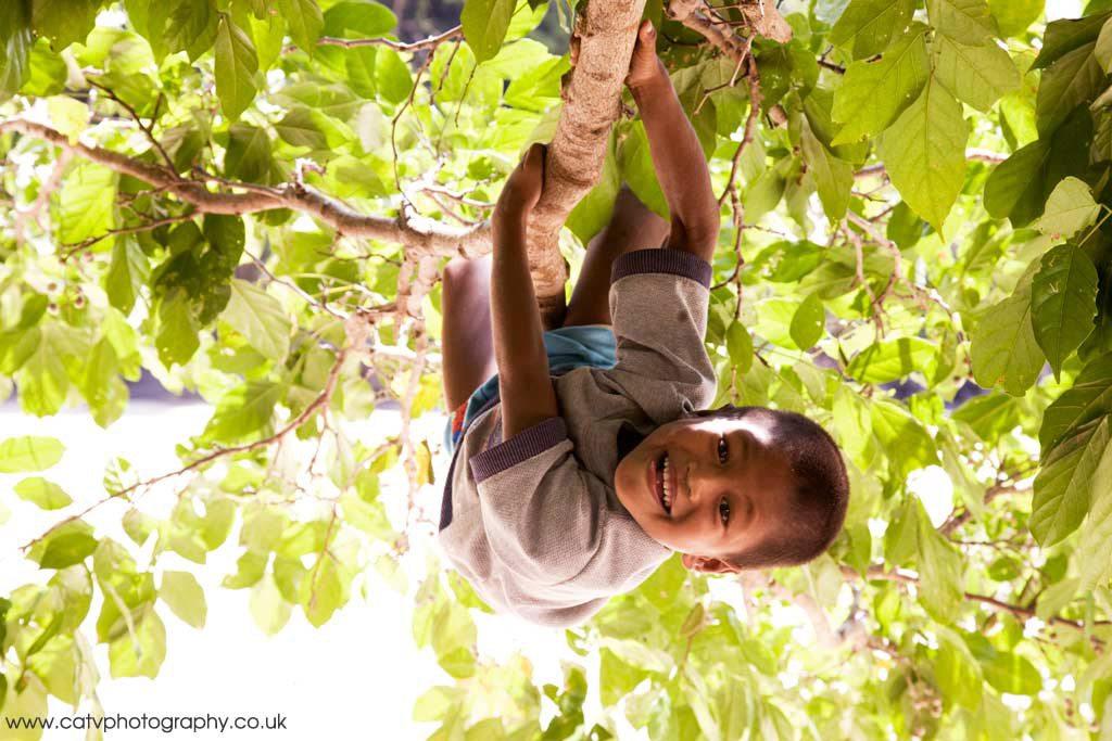 Moken Boy climbing